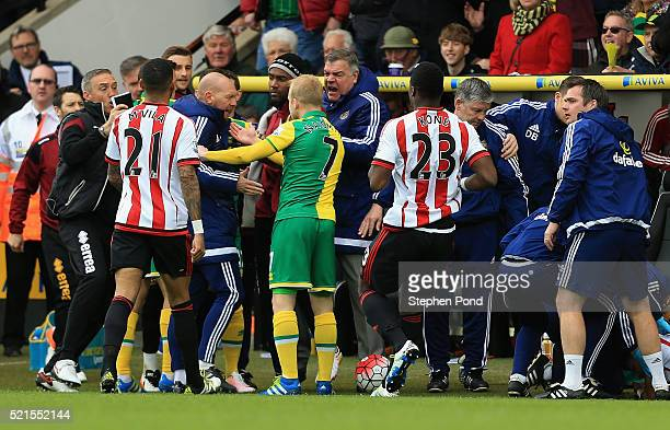 Norwich and Sunderland players confront one another including manager Sam Allardyce of Sunderland after Robbie Brady's tackle on DeAndre Yedlin...