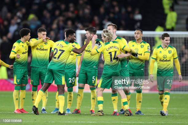 Norwich celebrate a successful penalty scored by Todd Cantwell during the FA Cup Fifth Round match between Tottenham Hotspur and Norwich City at...