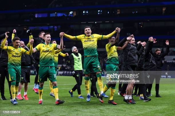 Norwich celebrate going through to the quarter-finals during the FA Cup Fifth Round match between Tottenham Hotspur and Norwich City at Tottenham...