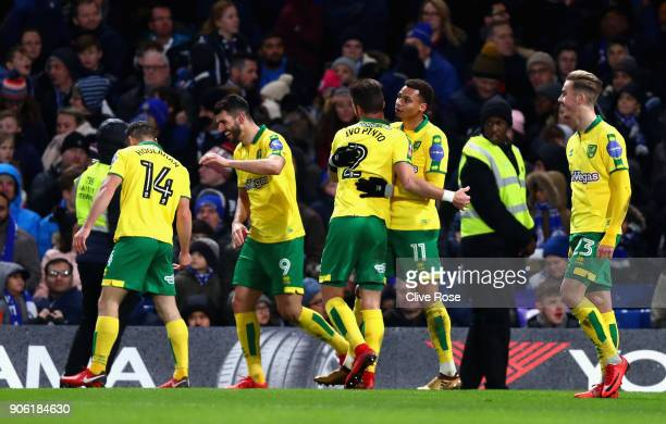 Norwich City celebrate after Jamal Lewis of Norwich City scores his sides first goal during The Emirates FA Cup Third Round Replay between Chelsea...