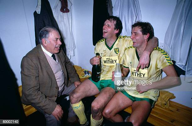 Norwich City Chairman Sir Arthur South joins Mike Channon and Asa Hartford who are celebrating in the dressing-room after Norwich had beaten Ipswich...