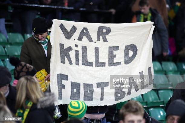 Norwich City fan holds an anti VAR sign during the Premier League match between Norwich City and Crystal Palace at Carrow Road on January 01, 2020 in...