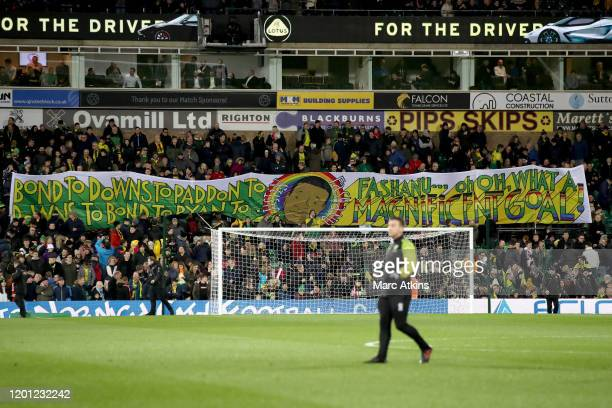 Norwich City fans display banner in the commemorating Justin Fashanu's 1980 goal of the season during the Premier League match between Norwich City...