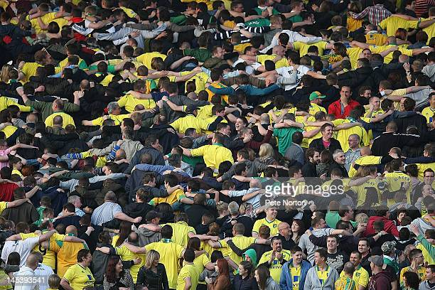 Norwich City fans perform a Poznan during the Adam Drury Testimonial Match between Norwich City and Celtic at Carrow Road on May 22 2012 in Norwich...