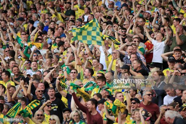 Norwich City fans show their support during the Premier League match between Norwich City and Newcastle United at Carrow Road on August 17, 2019 in...