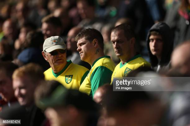 Norwich City fans stand dejected in the stands as their side is relegated after the Barclays Premier League match at Carrow Road Norwich
