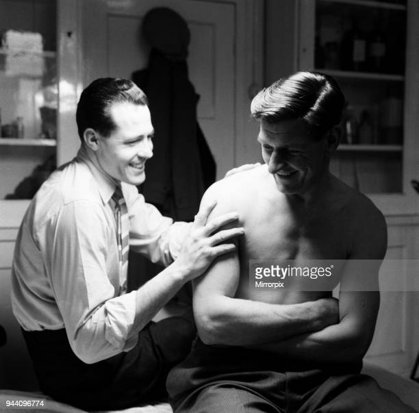 Norwich City FC players in dressing room Injured keeper Ken Nethercott has his shoulder massaged 3rd March 1959