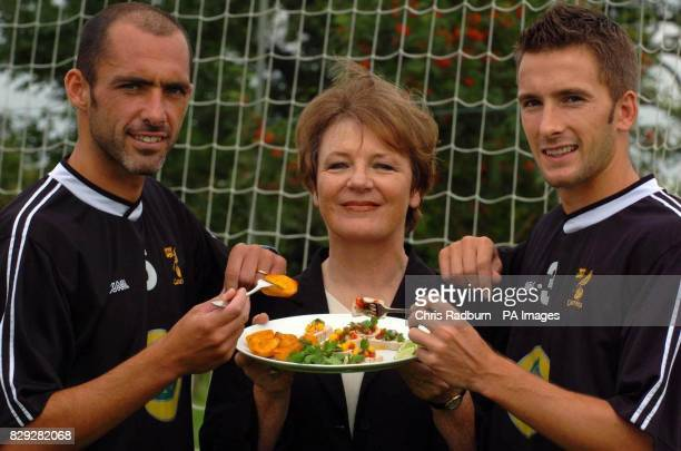 Norwich City Football Club Director Delia Smith is sandwiched between Norwich City players Adam Drury and Craig Fleming at the Norwich City training...
