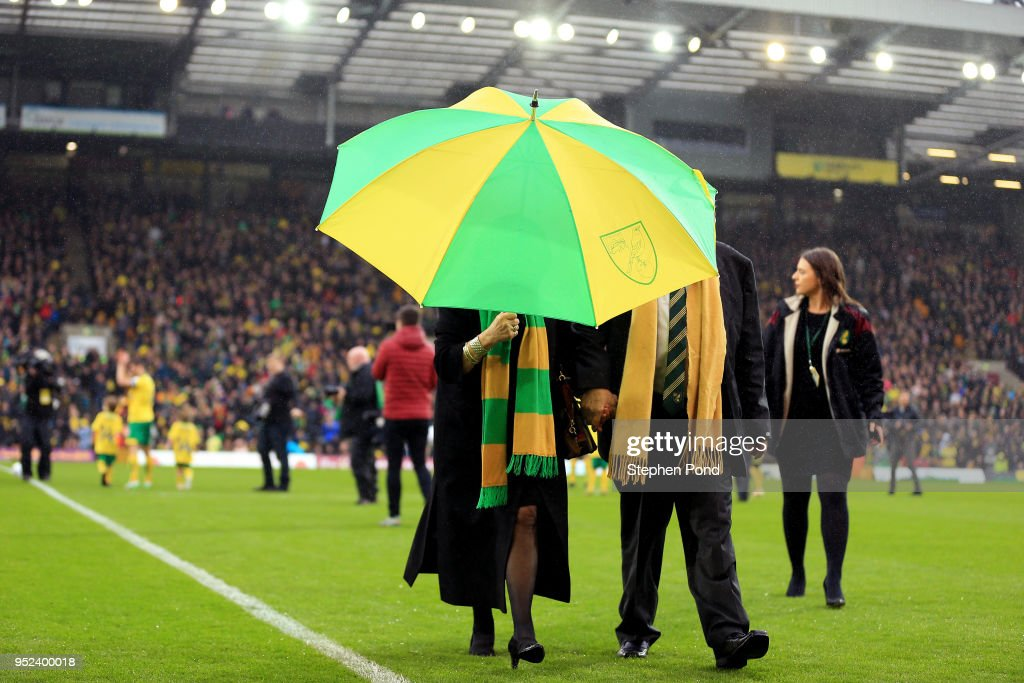 Norwich City Majority Shareholder Delia Smith walks off the pitch carrying an umbrella during the Sky Bet Championship match between Norwich City and Leeds United at Carrow Road on April 28, 2018 in Norwich, England.