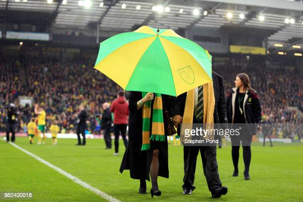 Norwich City Majority Shareholder Delia Smith walks off the pitch carrying an umbrella during the Sky Bet Championship match between Norwich City and...