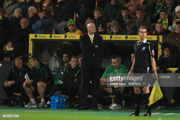 Norwich City manager Bryan Gunn looks on from the touchline