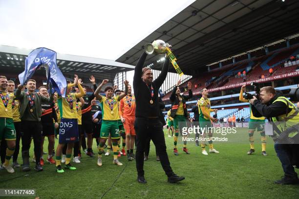 Norwich City manager Daniel Farke lifts the Championship trophy during the Sky Bet Championship match between Aston Villa and Norwich City at Villa...