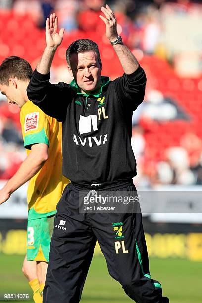 Norwich City manager Paul Lambert celebrates promotion to the Championship at the end of the CocaCola League One match between Charlton Athletic and...