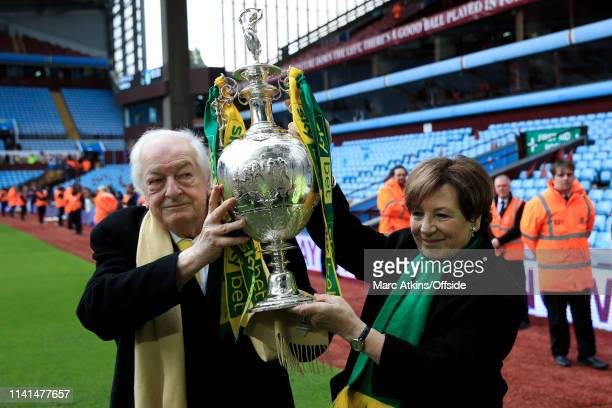 Norwich City owners Delia Smith and Michael WynnJones pose with the championship trophy during the Sky Bet Championship match between Aston Villa and...