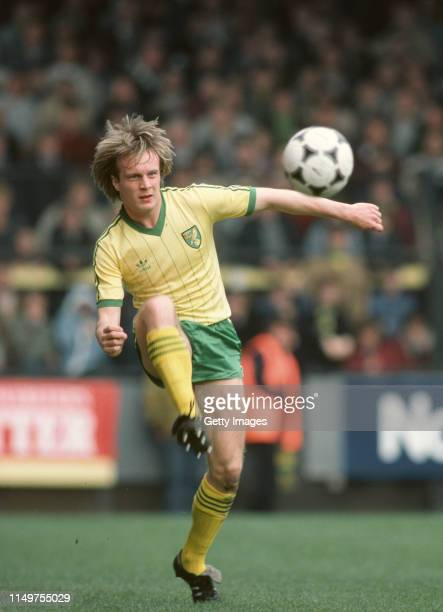 Norwich City player Paul Haylock in adidas home kit clearing an adidas Tango football during a League Division One match against Manchester United at...