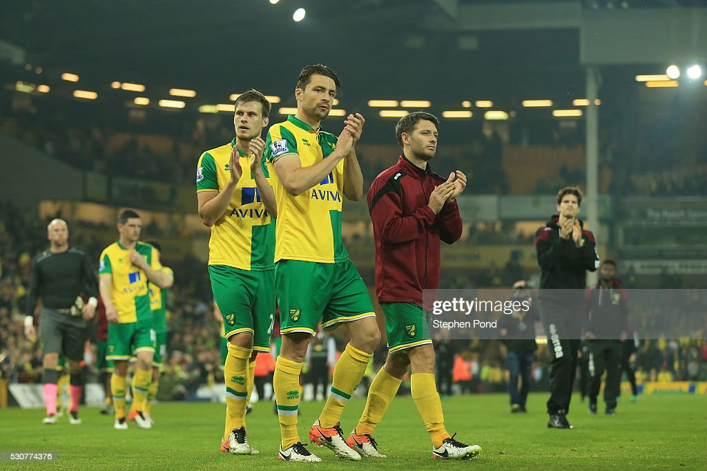 Norwich City players applaud supporters following relegation during the Barclays Premier League match between Norwich City and Watford at Carrow Road on May 11, 2016 in Norwich, England.
