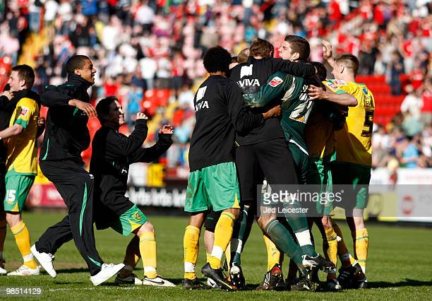 Norwich City players celebrate promotion to the Championship after the final whistle of the CocaCola League One match between Charlton Athletic and...