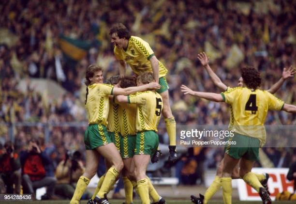 Norwich City players celebrate the own goal by Gordon Chisholm of Sunderland during the Football League Milk Cup Final between Norwich City and...