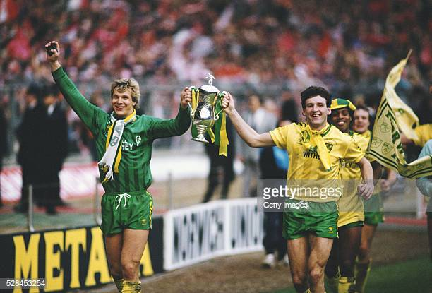 Norwich City players Chris Woods and Dave Watson celebrate with the trophy after the 1985 League Cup Final win against Sunderland at Wembley Stadium...