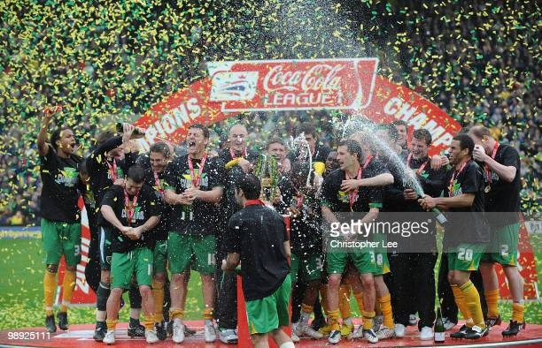 Norwich City players lift the CocaCola League One trophy after the CocaCola League One match between Norwich City and Carlisle United at Carrow Road...