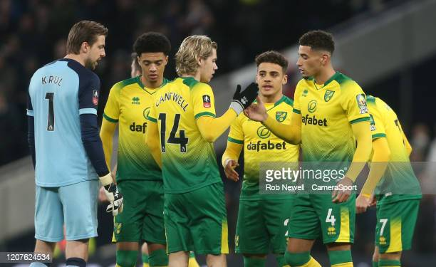 Norwich City players prior to kickoff during the FA Cup Fifth Round match between Tottenham Hotspur and Norwich City at Tottenham Hotspur Stadium on...
