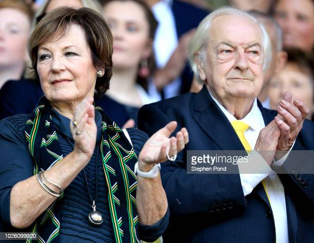 Norwich City shareholders Delia Smith and Michael WynnJones applaud prior to the Sky Bet Championship match between Ipswich Town and Norwich City at...