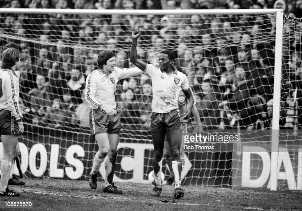 Norwich City striker Justin Fashanu is congratulated by Phil Hoadley after scoring the 3rd goal in their First Division match against Brighton Hove...