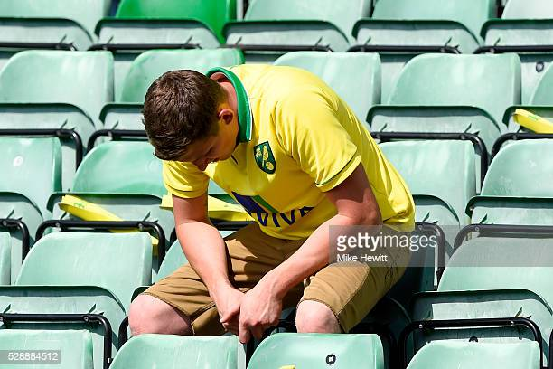 Norwich City supporters shows his dejection after his team's 01 defeat in the Barclays Premier League match between Norwich City and Manchester...