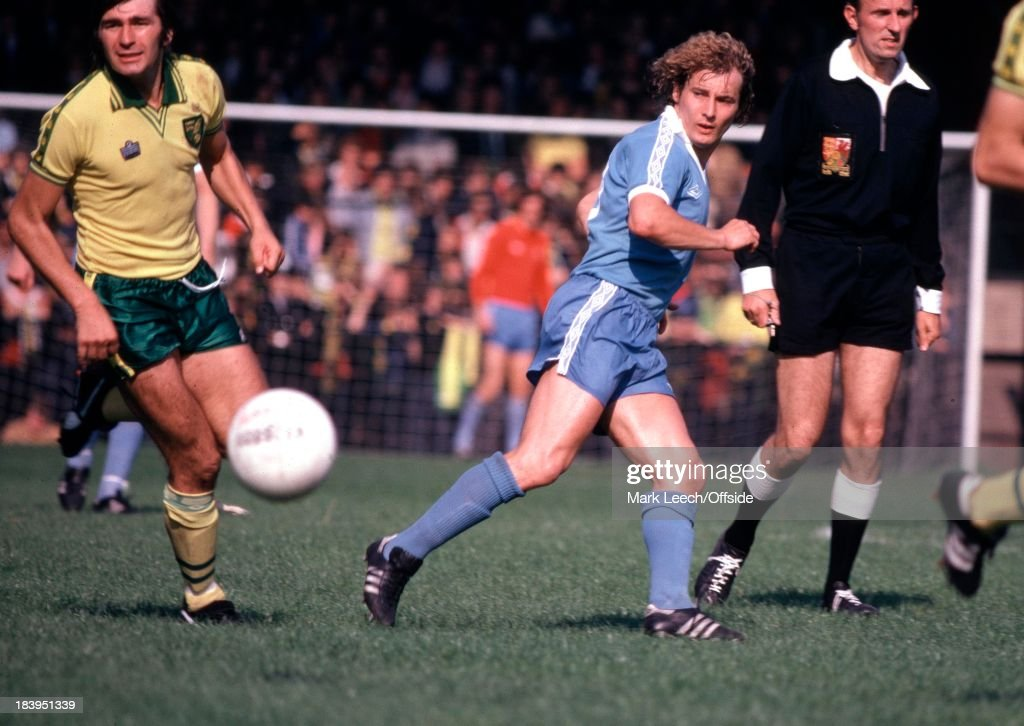 Norwich City v Manchester City, Asa Hartford passes the ball, watched by John Ryan of Norwich (left).