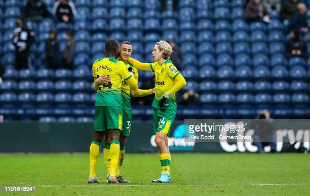 Norwich City's Adam Idah celebrates scoring his side's third goal with Ibrahim Amadou and Todd Cantwell during the FA Cup Third Round match between...