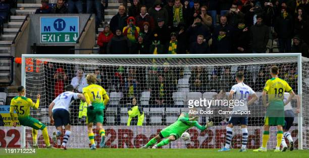 Norwich City's Adam Idah scores his side's fourth goal from the penalty spot during the FA Cup Third Round match between Preston North End and...