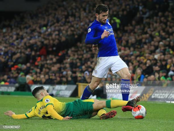 Norwich City's Argentinian midfielder Emiliano Buendía tackles Leicester City's English defender Ben Chilwell during the English Premier League...