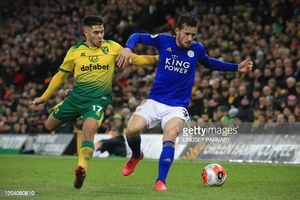 Norwich City's Argentinian midfielder Emiliano Buendía vies for the ball against Leicester City's English defender Ben Chilwell during the English...