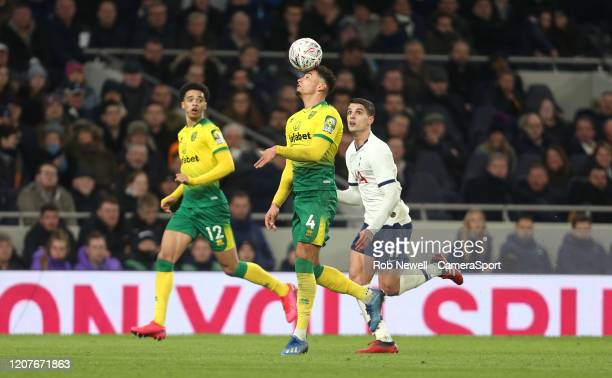 Norwich City's Ben Godfrey and Tottenham Hotspur's Erik Lamela during the FA Cup Fifth Round match between Tottenham Hotspur and Norwich City at...