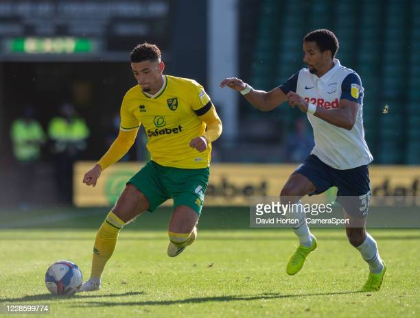 Norwich City's Ben Godfrey under pressure from Preston North End's Scott Sinclair during the Sky Bet Championship match between Norwich City and...