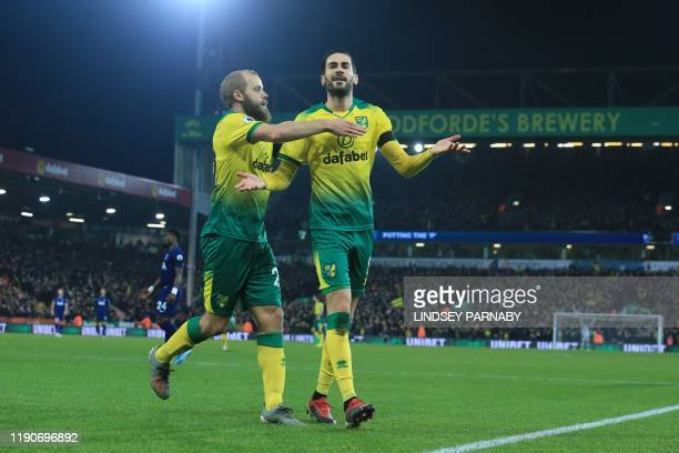 Norwich City's Bosnian midfielder Mario Vrancic celebrates scoring the opening goal with Norwich City's Finnish striker Teemu Pukki during the...