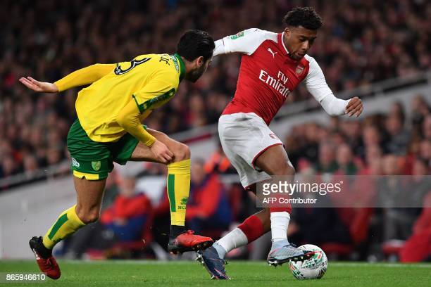 Norwich City's Bosnian midfielder Mario Vrancic vies with Arsenal's Nigerian striker Alex Iwobi during the English League Cup fourth round football...