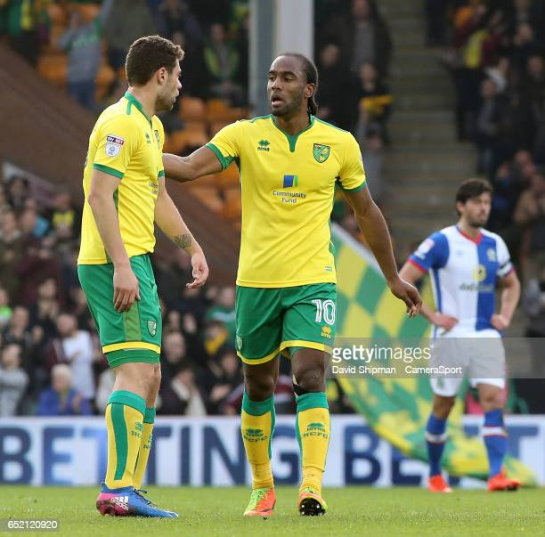 Norwich City's Cameron Jerome talks to Yanic Wildschut after making it 22 during the Sky Bet Championship match between Norwich City and Blackburn...