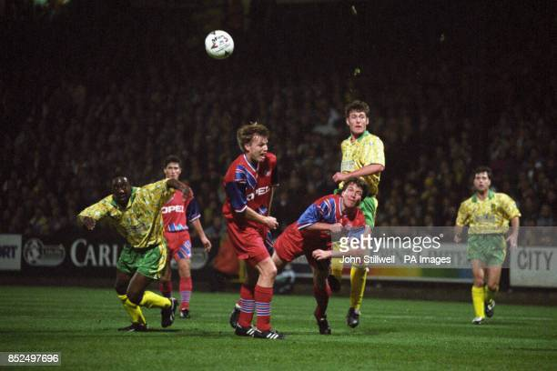 Norwich City's Chris Sutton shoots over the heads of Bayern Munich's Thomas Helmer and Lothar Matthaus Also pictured for Norwich City is Ruel Fox
