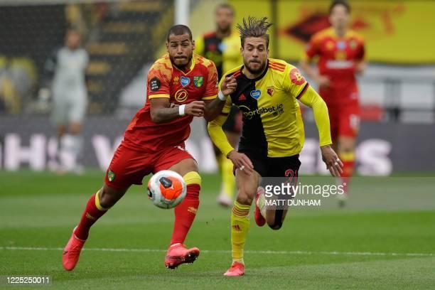 Norwich City's Cuban-born German midfielder Onel Hernandez vies for the ball with Watford's Spanish defender Kiko Femenia during the English Premier...
