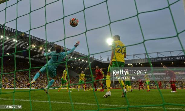 Norwich City's Dutch goalkeeper Tim Krul concedes a the third goal from Liverpool's Egyptian midfielder Mohamed Salah during the English Premier...