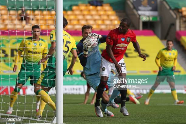 Norwich City's Dutch goalkeeper Tim Krul makes a save from Manchester United's Nigerian striker Odion Ighalo during the English FA Cup quarter-final...