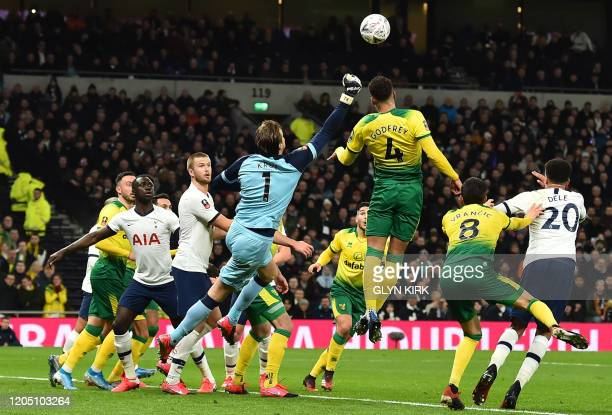 Norwich City's Dutch goalkeeper Tim Krul punches the ball during the English FA Cup fifth round football match between Tottenham Hotspur and Norwich...
