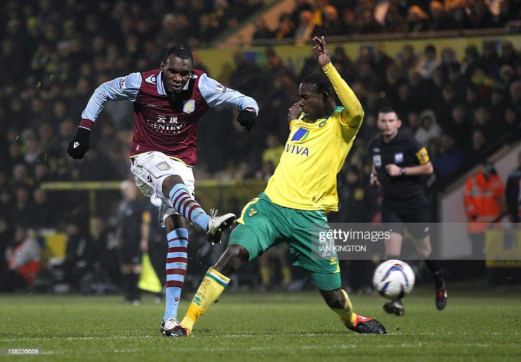 Norwich City's English defender Leon Barnett (R) tries to stop Aston Villa's Congolese-born Belgium striker Christian Benteke (L) from scoring his team's fourth goal during their English League Cup quarter final football match at Carrow Road stadium in Norwich, east England, on December 12, 2012. Aston Villa won the match 4-1.