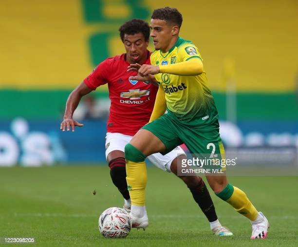 Norwich City's English defender Max Aarons clears from Manchester United's English midfielder Jesse Lingard during the English FA Cup quarterfinal...