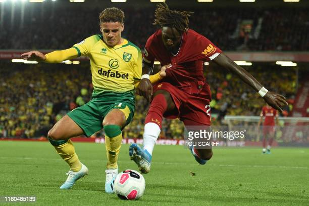 Norwich City's English defender Max Aarons vies with Liverpool's Belgium striker Divock Origi during the English Premier League football match...
