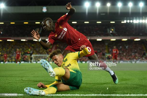 Norwich City's English defender Max Aarons vies with Liverpool's Senegalese striker Sadio Mane during the English Premier League football match...