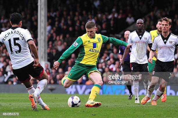 Norwich Citys English forward Gary Hooper has an unsiccessful shot at goal during the English Premier League football match between Fulham and...