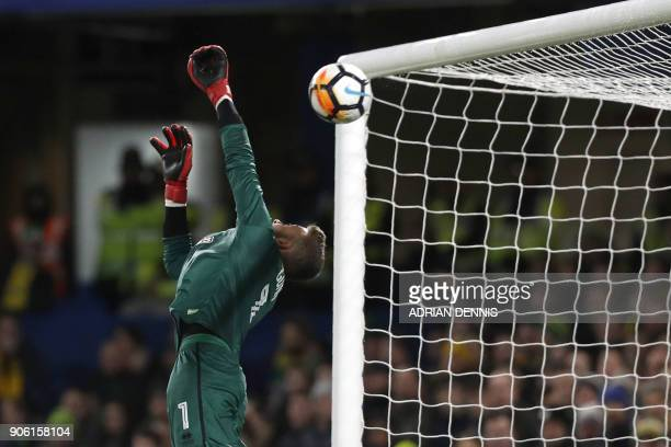 TOPSHOT Norwich City's English goalkeeper Angus Gunn leaps as Chelsea's English midfielder Danny Drinkwater's shot at goal hits the crossbar during...