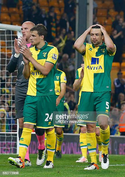 Norwich City's English goalkeeper John Ruddy Norwich City's Scottish defender Russell Martin and Norwich City's English defender Ryan Bennett on the...